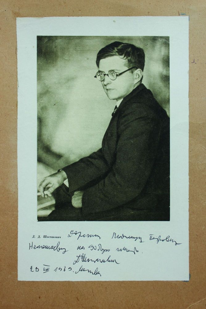 Printed image on a cardboard signed by Dmitrii Shostakovich. Dmitrii SHOSTAKOVICH.